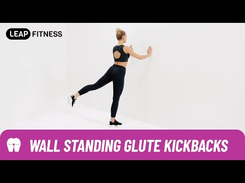 How to Do:WALL STANDING GLUTE KICKBACKS